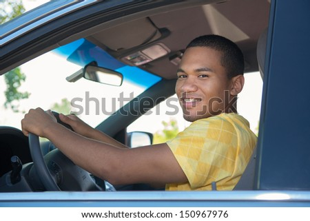 Young Smiling African American Male in Driver Seat Car - stock photo