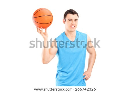 Young smiling basketball player in blue dress posing with a ball isolated on white background - stock photo