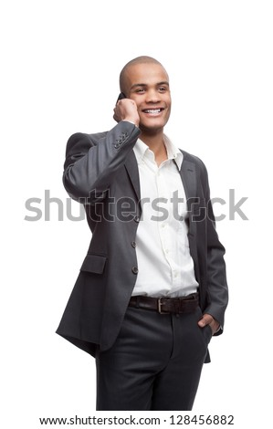 young smiling black businessman talking on cell phone isolated on white - stock photo