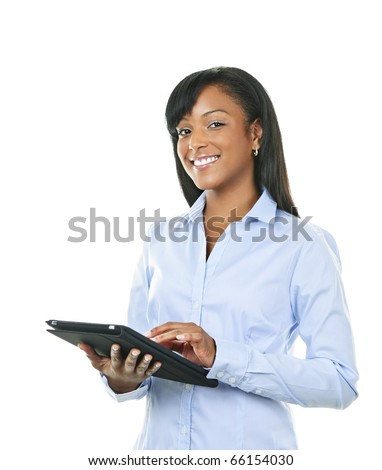Young smiling black woman using tablet computer - stock photo