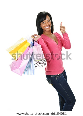 Young smiling black woman with shopping bags giving thumbs up - stock photo