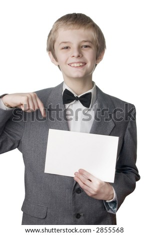 Young smiling boy signing on blank card. Very useful place for the text  inserting - stock photo
