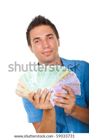 Young smiling business man showing handful of money isolated on white background