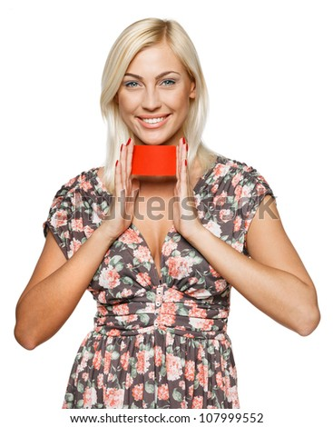 Young smiling business woman holding credit card with both hands, isolated on white background
