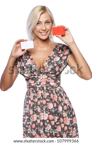 Young smiling business woman holding two credit cards isolated on white background - stock photo