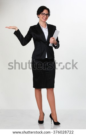 Young smiling business woman. Isolated over white background - stock photo