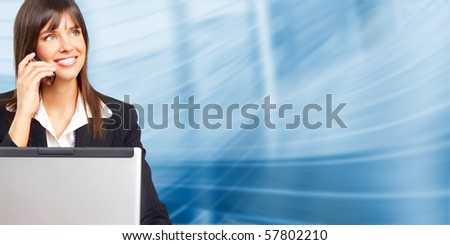Young smiling  business woman with laptop and cellular - stock photo