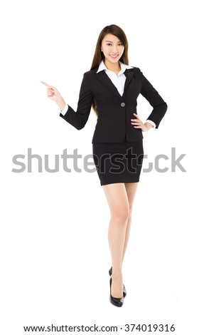 young smiling business woman with pointing gesture - stock photo