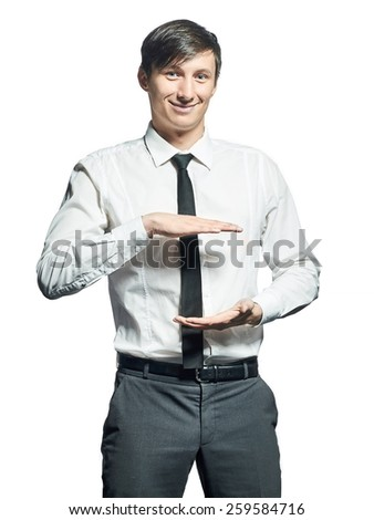 Young smiling businessman holding something over white background - stock photo