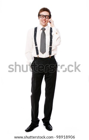 Young smiling businessman using cell phone over white background - stock photo