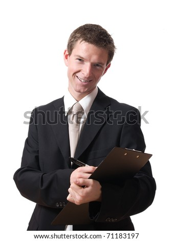 young smiling businessman writing on a pad isolated on white background - stock photo