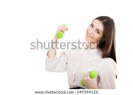 Young smiling businesswoman in white shirt trains biceps lifting dumbbell weights, workout, business training, strength, progress, success, leadership concepts, isolated on white background - stock photo