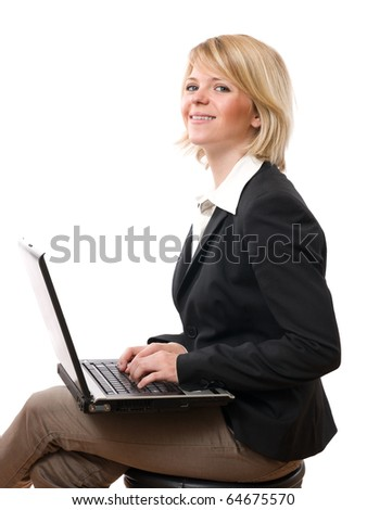 young smiling businesswoman working with laptop - stock photo