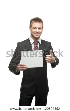 young smiling caucasian businessman in black suit and santa hat holding sign isolated on white