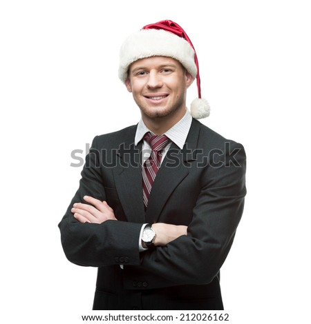 young smiling caucasian businessman in black suit and santa hat  isolated on white - stock photo