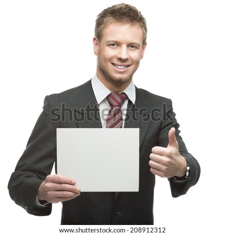 young smiling caucasian businessman in black suit holding sign isolated on white