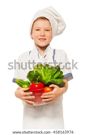 Young smiling cook with bowl of fresh vegetables