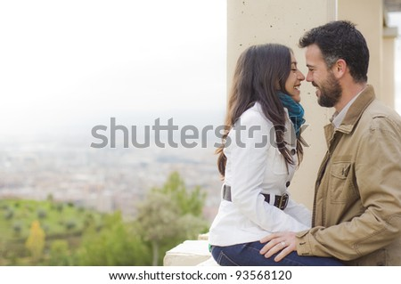 Young smiling couple embraced - stock photo