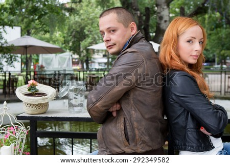 Young smiling couple looking on each other - stock photo