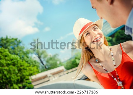Young smiling couple outdoors - stock photo