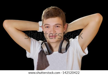 Young smiling dj man with headphones isolated on black - stock photo