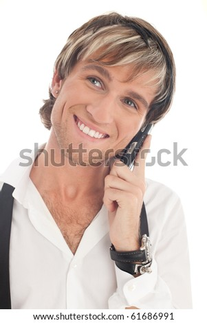 Young smiling fashionable man calling by mobile phone. Isolated on white