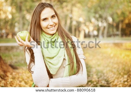 young smiling girl enjoying in autumn