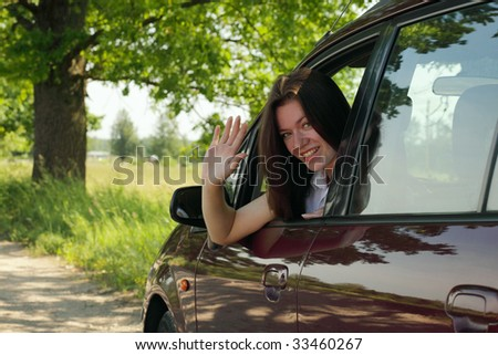 young smiling girl  in car