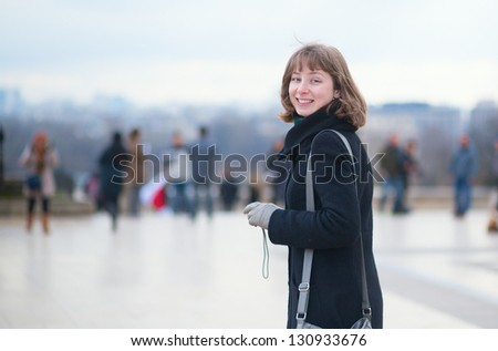 Young smiling girl in Paris