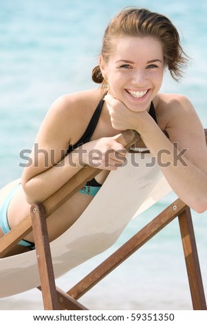 young smiling girl on beach - stock photo