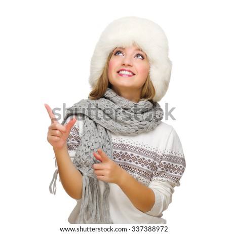 Young smiling girl pointing up isolated - stock photo