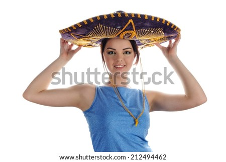 Young smiling girl trying on Mexican sombrero. Portrait on white background - stock photo