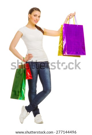 Young smiling girl with bags isolated - stock photo