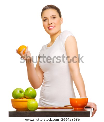 Young smiling girl with fruits isolated - stock photo