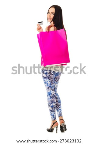 Young smiling girl with red paper bags and credit card isolated - stock photo