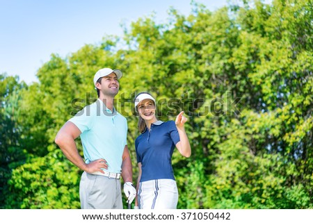 Young smiling golfers outdoors