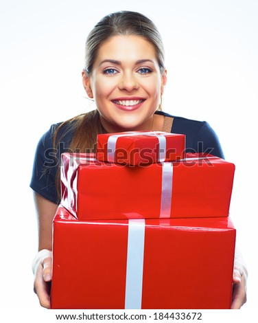 Young smiling model hold gift box. Woman isolated on white background. - stock photo