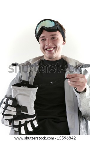 Young smiling snowboarder holding glove, isolated - stock photo