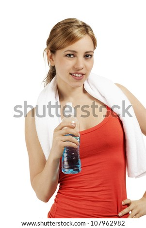 young smiling sporty woman with a bottle of water on white background - stock photo