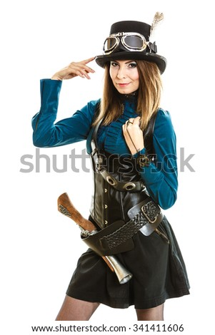 Young smiling steampunk islolated girl on white wearing fancy hat. Fantasy old fashion with stylish topper and goggle.