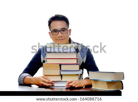 Young smiling student with stack of books