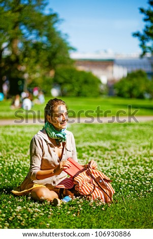 Young smiling student woman with book. - stock photo