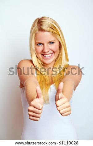 young smiling successful woman with thumb up - stock photo
