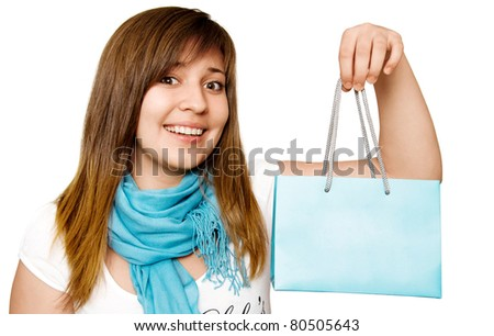 young smiling teenage girl with a shopping bag in his hands