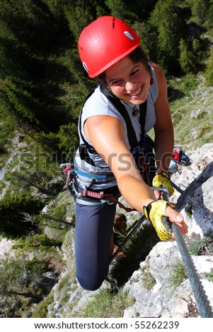 Young smiling woman climbing in the nature - stock photo