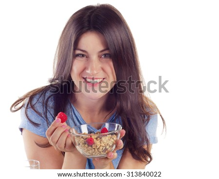 Young smiling woman eating healthy breakfast isolated on white background