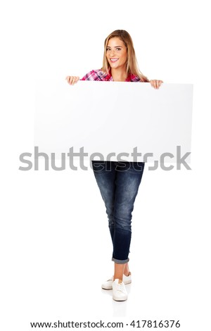 Young smiling woman holding empty banner