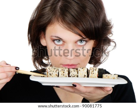 Young smiling woman holding sushi - stock photo