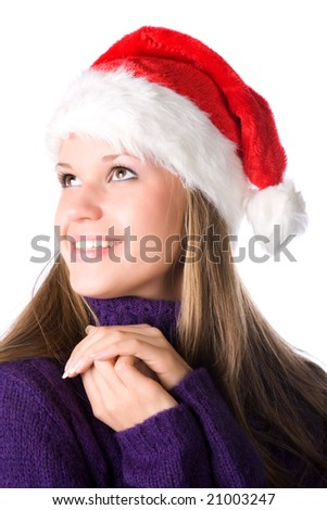 Young smiling woman in santa hat portrait. Isolated on white. - stock photo