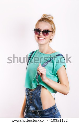 young smiling woman in sunglasses .Closeup fashion beautiful woman portrait wearing sunglasses.Casual girl having fun.Young active people - stock photo